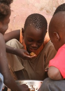 Children in Senegal enjoy a filling meal cooked on a 100 Liter nstitutional Cookstove by InStove. SSB